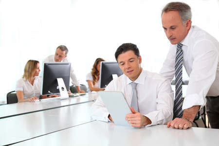 workmates: Business team working in the office Stock Photo