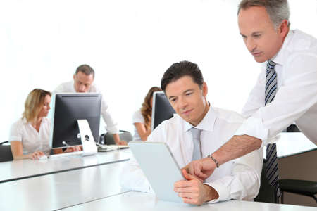 android tablet: Business team working in the office Stock Photo