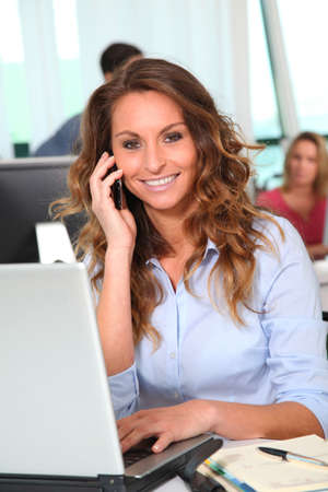 telephone saleswoman: Smiling businesswoman talking on the phone Stock Photo