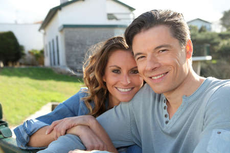 home ownership: Portrait of happy new property owners
