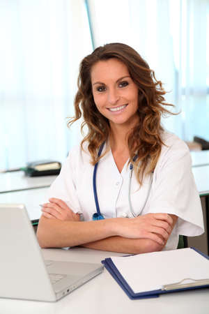 Portrait of beautiful smiling nurse at work photo