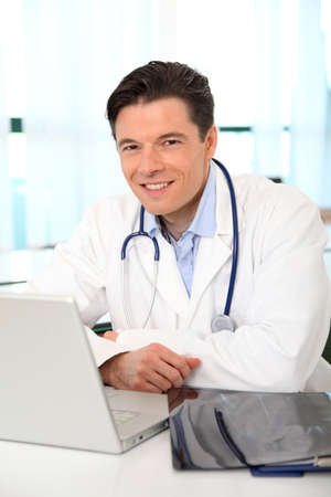 Portrait of smiling doctor working in the office photo