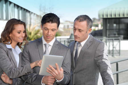 android tablet: Business people meeting outside with electronic tablet