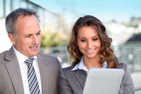Business partners working on electronic tablet  photo