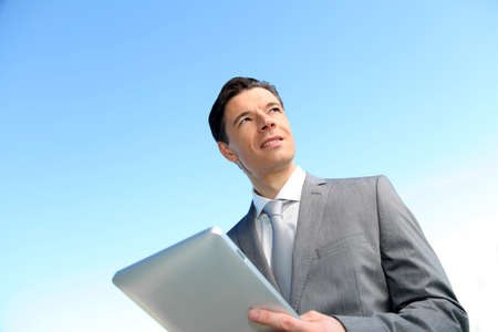 Portrait of businessman working on electronic tablet Stock Photo - 8916365