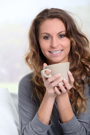 Portrait of woman holding cup of tea photo
