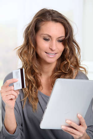 secured payment: Woman doing online shopping at home Stock Photo