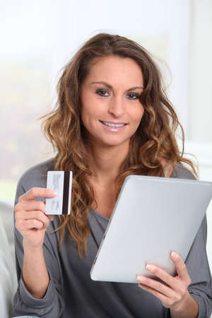 Woman doing online shopping at home Stock Photo - 9002091