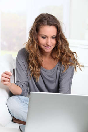 Woman doing online shopping at home Stock Photo - 9002115