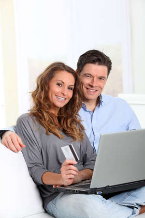 secured payment: Couple at home doing online shopping