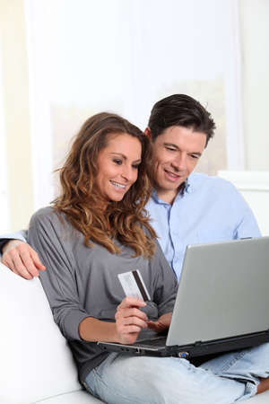 online payment: Couple at home doing online shopping
