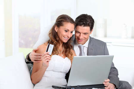 Bride and groom doing shopping on inernet at home Stock Photo - 9002084