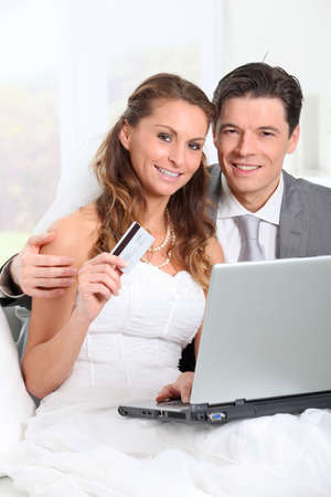 Bride and groom doing shopping on inernet at home Stock Photo - 9002131
