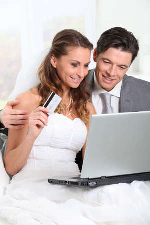 Bride and groom doing shopping on inernet at home Stock Photo - 9002070