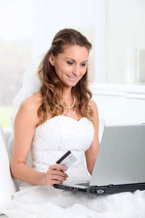 wedding gawn: Bride doing online shopping at home Stock Photo