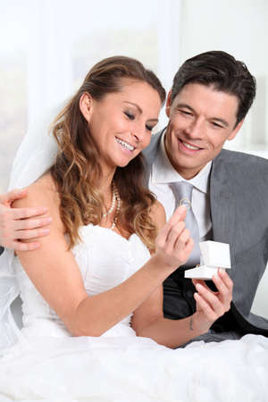 Bride and groom looking at their wedding rings Stock Photo