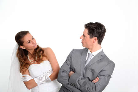 Married couple expressions on white background photo
