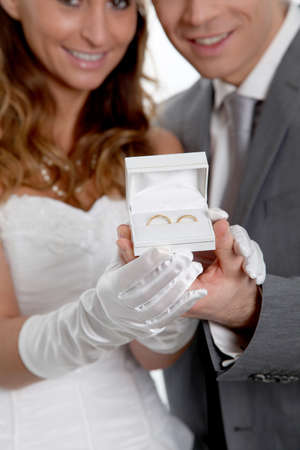 Bride and groom holding wedding rings Stock Photo - 9002074