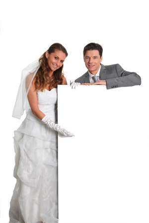 Bride and groom holding whiteboard Stock Photo - 9002042