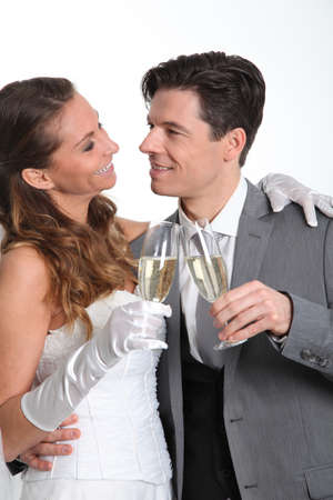 champain: Bride and groom drinking champagne
