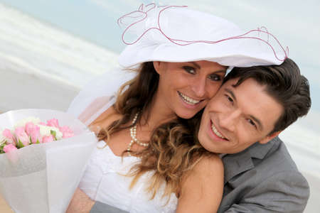 wedding gawn: Portrait of happy married couple at the beach