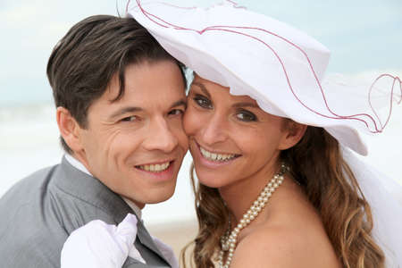 Portrait of happy married couple at the beach photo
