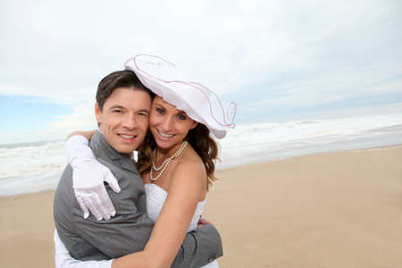 Portrait of happy married couple at the beach