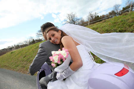 Married couple riding motorcycle on their wedding day Stock Photo - 9002145