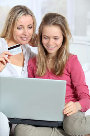 secured payment: Mother and daughter shopping on internet