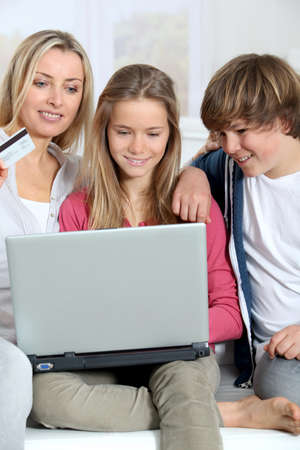 Mother and children at home doing online shopping Stock Photo - 9002177
