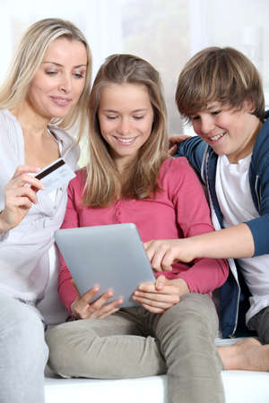 Mother and children doing online shopping photo