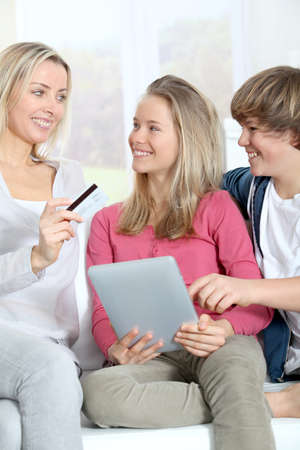 Mother and children doing online shopping Stock Photo - 9002167