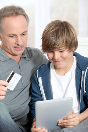 Father and son doing online shopping photo