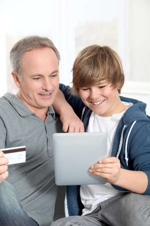 secured payment: Father and son doing online shopping