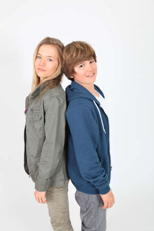 Teenagers standing on white background photo