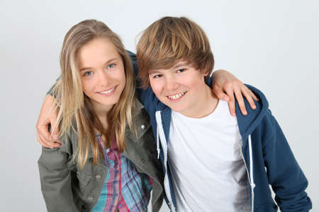 Portrait of teenagers standing on white background photo