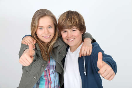Portrait of teenagers with thumbs up photo