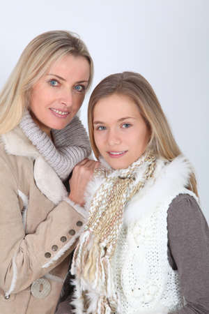 Portrait of beautiful blond mother and daughter photo