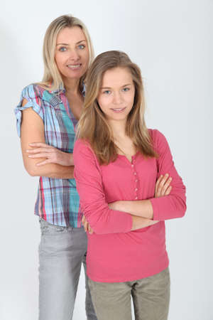 Portrait of smiling blond mother and daughter Stock Photo - 9002085