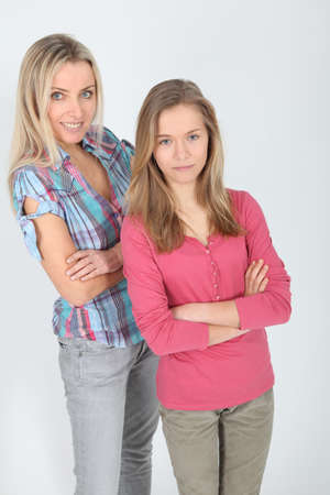 Portrait of smiling blond mother and daughter photo