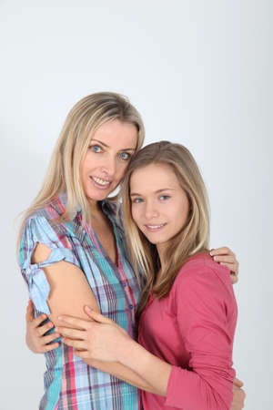Portrait of smiling blond mother and daughter Stock Photo - 9002179