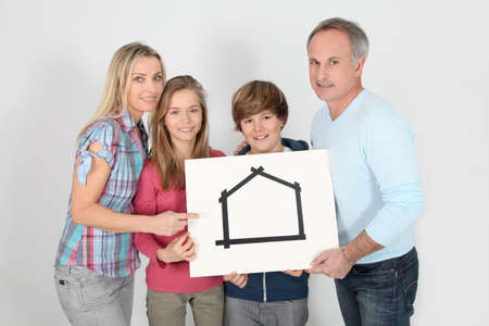 Portrait of happy family holding message board photo