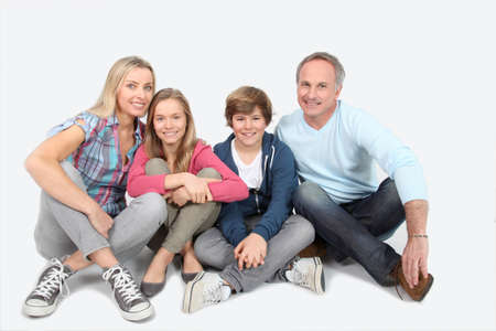 Happy smily family sitting on white background photo