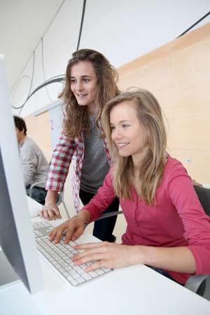 traineeship: Teenage girls in front of desktop computer at school Stock Photo