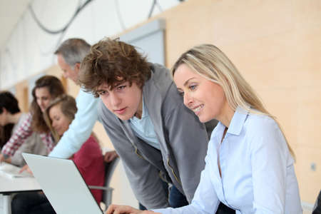 traineeship: Teacher and teenage boy in front of laptop computer Stock Photo