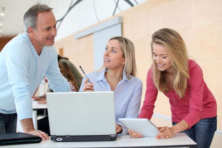 internship: Teachers and teenage girl in front of computer  Stock Photo