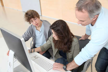 traineeship: Teacher and students attending computing training course Stock Photo