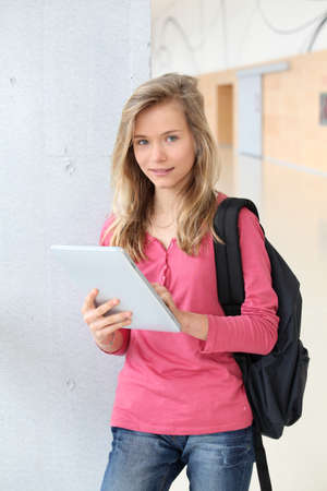 Teenage girl using electronic tablet at school Stock Photo - 9010182