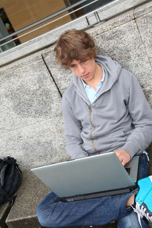 Student with laptop computer outside school building Stock Photo - 9021112