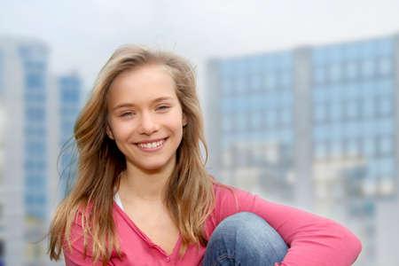 Closeup of teenage girl sitting on a school bench Stock Photo - 9010064